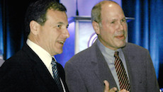 Michael Eisner, outgoing chief executive officer of The Walt Disney Co., right, and incoming CEO Robert Iger speak to guests at a luncheon meeting of the Hollywood Radio and Television Society, a group of entertainment industry executives, in Beverly Hills, Calif., Tuesday, Sept. 27, 2005.   While Sept. 30 marks the end of the 21-year tenure of Eisner as chief executive of Disney, his successor, Iger, is wasting no time planning for the future.  (AP Photo/Reed Saxon) ORG XMIT: CARS103